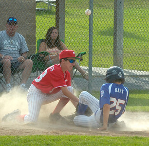 Saratoga National's Brian Hart is safe at third as the ball gets away from Mechanicville-Stillwater's Jason McClements during Tuesday's game at West Side Rec Field. Hart was able to score on the play.  Ed Burke 7/3/12