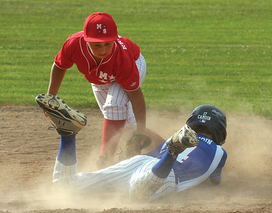 Saratoga National's Garret Camoin is out at second as Mechanicville-Stillwater's Ty Kraszewski makes the play. Although Camoin beat the throw, he was called out because of an illegal head-first slide. Ed Burke 7/3/12