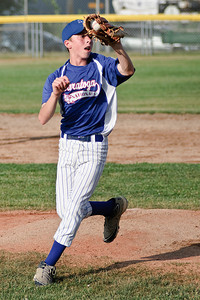 Pitcher Garrett Camoin catches an infield hit during the game against Carman Monday evening. Photo Eric Jenks 7/16/12