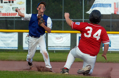 Saratoga American's shortstop Nick Kondo tags out Connor Demyer, of Carman, at second base as he throws the ball to first, making a double-play during semi-final sectional baseball game at East Side Rec. Photo Erica Miller 7/22/11 spt_SALL1_Sat