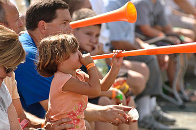 Gabriella Montalto blows her horn in support of Clifton Park during the 2011 Babe Ruth World Series Game against Guilderland Friday Morning. Photo By Eric Jenks 8/27/11