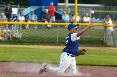 Saratoga American's shortstop Austin Patterson catches a ground ball and pitches the ball to first base during the semi-final sectional baseball game against Carman Friday afternoon at East Side Rec. Photo Erica Miller 7/22/11 spt_SALL4_Sat