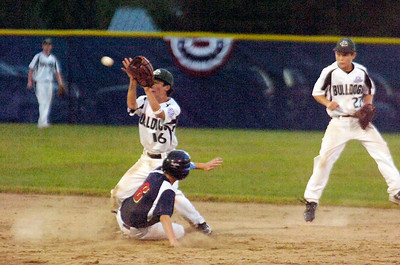 Tri-Valley's Quinn Cambra slides into second base as Clifton Park's Zack Sargent catches the ball during their Championship game for Babe Ruth 13 year-old Friday evening.Photo Erica Miller 8/26/11 CPvsTRI5