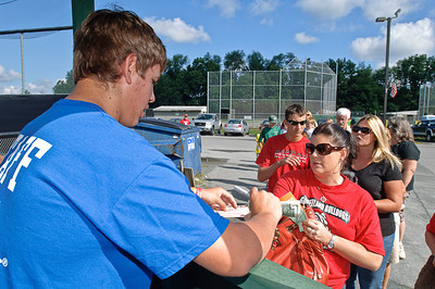 Debbie Peda gets her tickets from Aaron Selig Friday Morning before the start of the 2011 Babe Ruth World Series game between Clifton Park and Guilderland. Photo By Eric Jenks 8/27/11