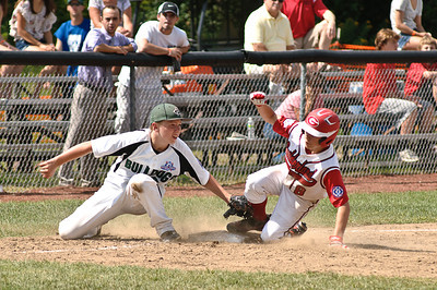 Clifton Park Bulldog Frankie Pizzo falls short of tagging Guilderland's Ryan Cullam out Friday Morning during their 2011 Babe Ruth World Series Game. Photo By Eric Jenks 8/27/11