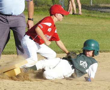 Clifton Park's Jake Reinisch is safe on a steal to second as he beats the tag by Wilton's Dan Moshier. Ed Burke 7/27/11
