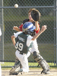 Wilton Rebel catcher Jack O'Leary was able to get the out on Clifton Park's Adam McCarvill during Wednesday's game at Gavin Park. Ed Burke 7/27/11