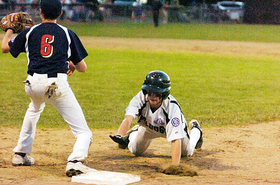 Clifton Park's Daniel Gregory slides safely back to first base as first baseman Tri-Valley's Quinn Cambra during their Championship game for Babe Ruth 13 year-old Friday evening.Photo Erica Miller 8/26/11 CPvsTRI7