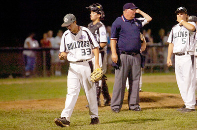 Clifton Park's pitcher Liam Harrison walks off the mound after getting his hand injured by a hit from Tri Valley during the Babe Ruth League 13-year-old Championship on Friday evening. Photo Erica Miller 8/27/11 spt_BabeRuth3_Sat
