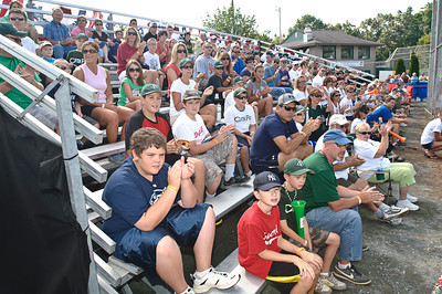 The Crowd cheers and claps while the Clifton Park Bulldogs take to the field Friday Morning before the 2011 Babe Ruth World Series. Photo By Eric Jenks 8/27/11