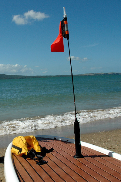 SUP with Tallon Kayak Safety Flag & a dry bag attached by a Tallon loop