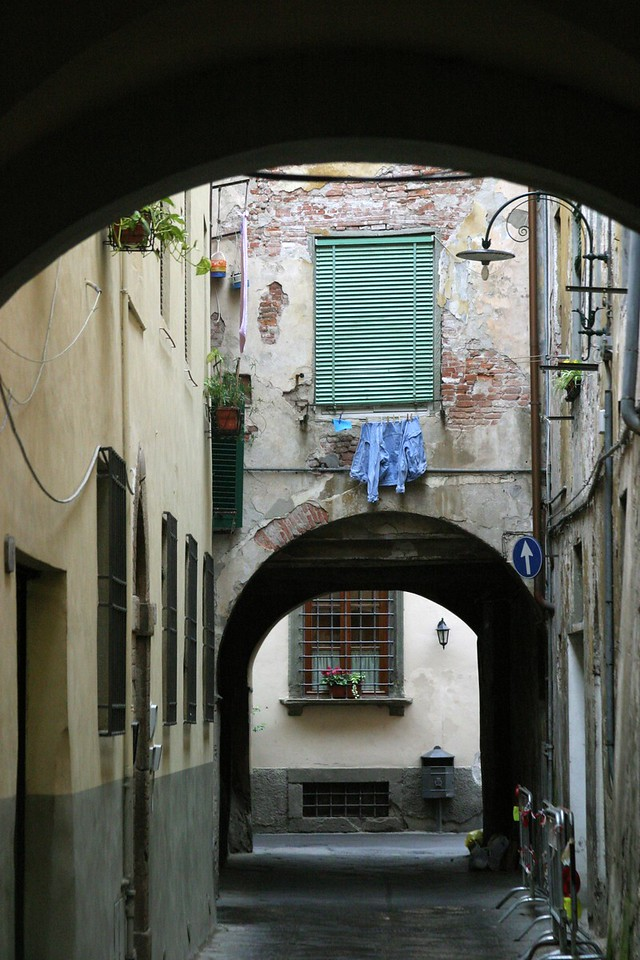 Arch with Blue Shirt Lucca, Italy