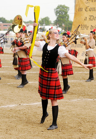 Guard member Ashley Mills competes with the Anderson Marching Highlanders during State Fair Band Day on Friday.