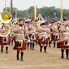 The Anderson Marching Highlanders march onto the field during State Fair Band Day on Friday.