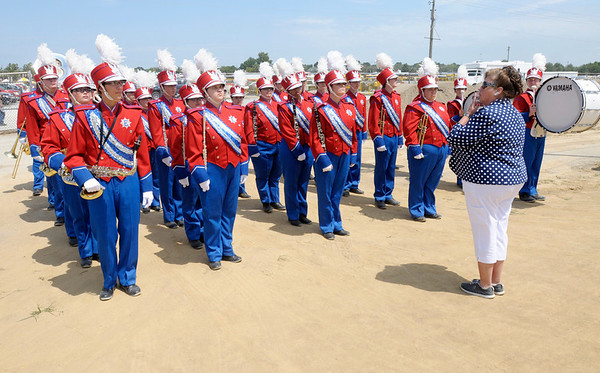 Elwood band director Paula Simmons gives the Marching Panthers final instructions as they wait their turn to compete during  State Fair Band Day on Friday.