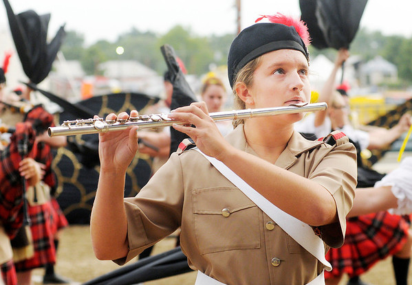 Mia Speer competes with the Marching Highlanders during State Fair Band Day on Friday.