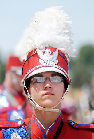 Kody Worland waits to compete with the rest of the Elwood Panther Band during State Fair Band Day on Friday.