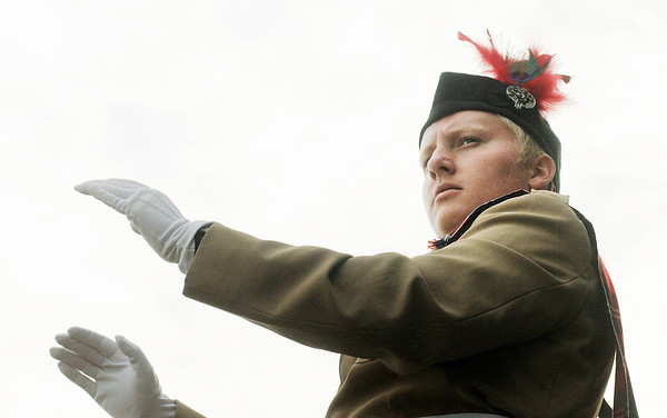 Drum major Conner Oleksy directs the Anderson Marching Highlanders as they compete during State Fair Band Day on Friday.