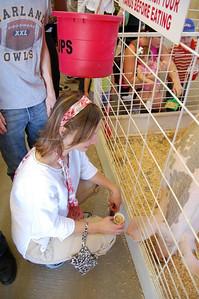 Cali Feeding a Pig - Great State Fair of Texas