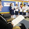 SENTINEL & ENTERPRISE / JONATHAN PHILLIPS<br /> State Rep. Jennifer Flanagan listens as students from Denise Lawson's third grade class perform a play for Community Reading Day at St. Anna's School in Leominster, Wednesday morning.