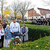SENTINEL & ENTERPRISE / BRETT CRAWFORD<br /> From left, State Senator Jennifer Flanagan; Mrs. Pauline Roberge, Gold Star Mother; Mrs. Helen Hill, Gold Star Mother; Mr. John Roberge; and City Councilor Claire Freda, Gold Star Wife, stand after laying the memorial wreath as the 15th Mass. Vol. Infantry give a rifle salute during the Laying of Memorial Wreath Ceremony on the Common during Veterans Day, Wednesday.