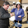 SENTINEL & ENTERPRISE / SARAH BRITAIN  State Reps. Stephen DiNatale and Jennifer Flanagan don construction hats for the ceremonial groundbreaking for the Twin Cities Community Development Corporations's TD Banknorth building project in Fitchburg, Friday.