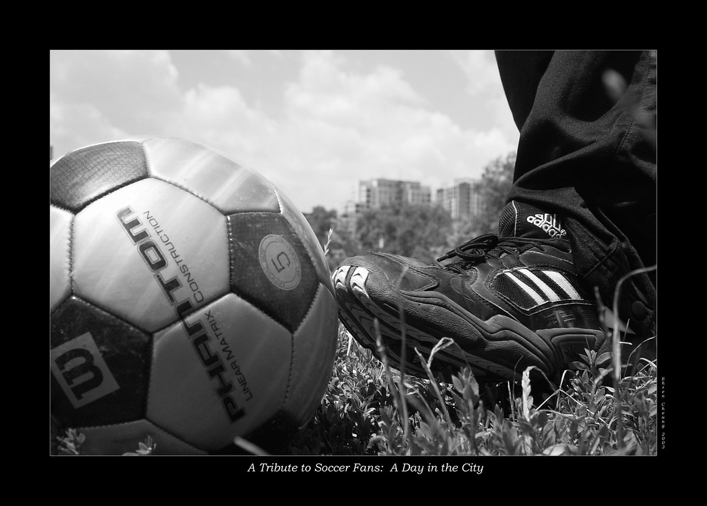 A Tribute to Soccer Fans:  A Day in the City - a good friend assisted me in this photograph after I requested him to align his foot in the photograph for probably half an hour while I figured out the best shot.<br /> <br /> On another note:  This was taken on an actual soccer/football field.