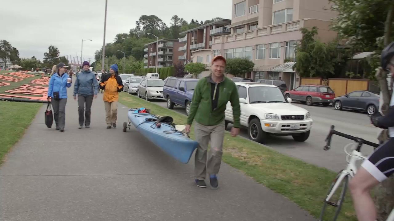 Interview Man Walking Kayak