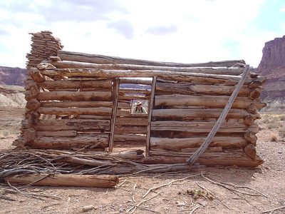 """Remnants of the """"Outlaw Cabin"""" at Fort Bottom. No """"Butch Cassidy Slept Here"""" sign, although rumor is he did. In any case, the cabin was around while Cassidy was still alive, and was used as a refuge by river runners starting in the early 1900s. Day 1."""