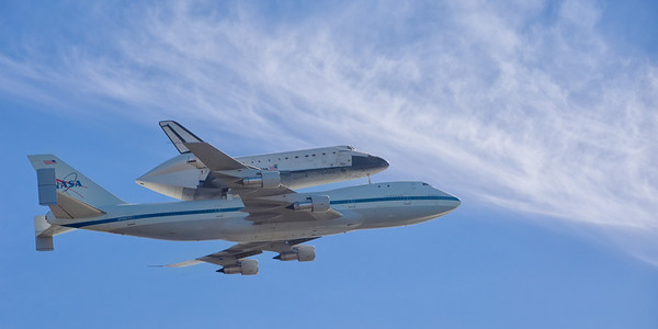 On the first pass, the plane and shuttle were nicley framed against the blue sky and clouds