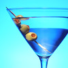 Colorful martini with olives