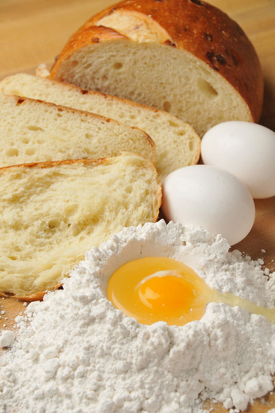 Baking ingredients, bread, flour and eggs
