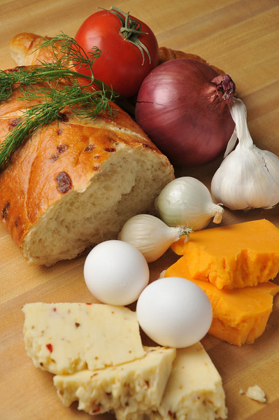 Baking ingredients, bread, onions, cheese, eggs, garlic