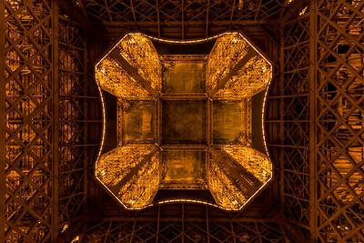 Bottom view on illuminated Eiffel tower, Paris, France