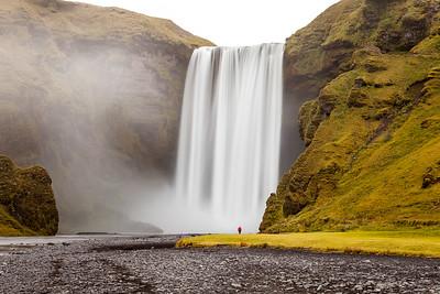 Skógafoss waterfall under Mýrdalsjökull glacier, South Iceland