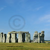 The entire prehistoric stone ring of Stonehenge in England, at the summer solstice against a backdrop of Salisbury Plain