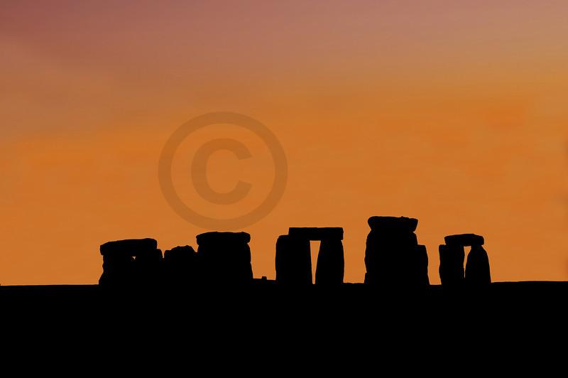 flaming sunset over stonehenge