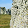 The heal stone with Stonehenge in the background at the summer solstice in England
