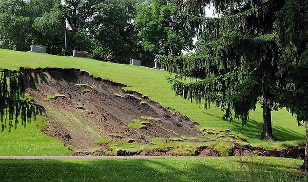 Part of a hillside in Glenwood Cemetery broke free and slid down the hill Wednesday. Photo by Pat Christman
