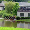 Homeowners watch as water overflowing from a swelled retention pond sits behind a home on South Brook Circle in Mankato Wednesday. Photo by Pat Christman