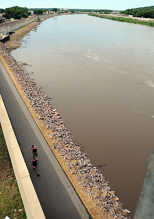 People walking along the Minnesota River in downtown Mankato Wednesday are greeted by hight water after recent rains. Photo by Pat Christman