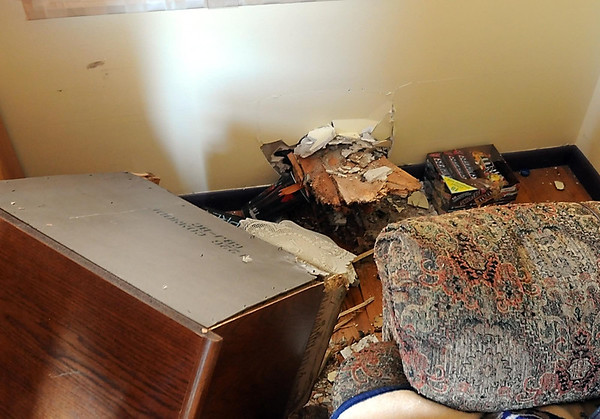 Part of a tree that was struck by lightning embedded itself in a bedroom at Ross and Carol Chapman's home in Mankato. Photo by Pat Christman