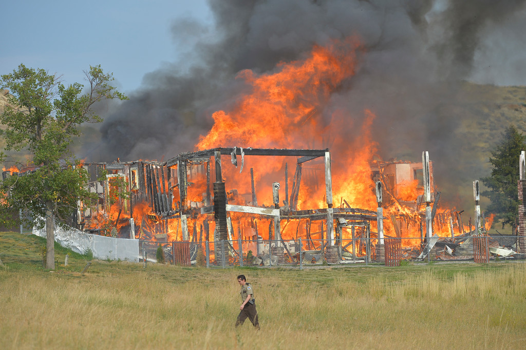 Justin Sheely | The Sheridan Press<br /> Flames blaze in a structure fire at 5 Chinook Drive off Decker Road north of Sheridan on Wednesday. Sheridan Fire-Rescue and Goose Valley Volunteer Fire Department responded to the call of a structure fire around 5 p.m. The resident and her dog made it out safely. No injuries were reported. The house was a complete loss.
