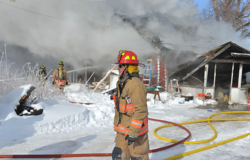 Justin Sheely | The Sheridan Press<br /> <br /> Sheridan Fire-Rescue captain Gary Harnish look over the scene of a structure fire at a residence on Coffeen Avenue Wednesday, Feb. 20, 2018. Sheridan Fire-Rescue, Goose Valley Volunteer Fire Department and Rocky Mountain Ambulance responded to a structure fire call at 9:58 a.m. Wednesday at 5461 Coffeen Ave.