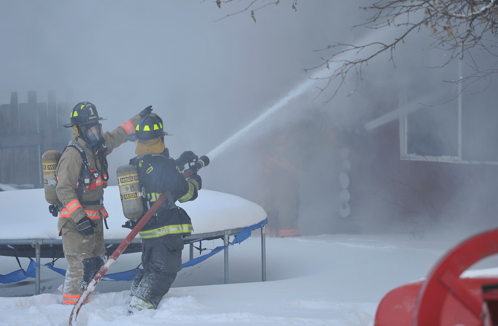 Justin Sheely | The Sheridan Press<br /> <br /> Firefighters spray water at a structure fire at a residence on Coffeen Avenue Wednesday, Feb. 20, 2018. Sheridan Fire-Rescue, Goose Valley Volunteer Fire Department and Rocky Mountain Ambulance responded to a structure fire call at 9:58 a.m. Wednesday at 5461 Coffeen Ave.