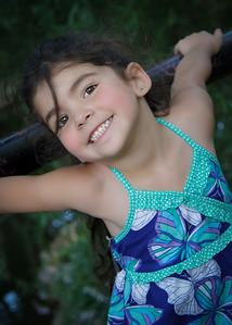 Bella on Fence Big Smile-