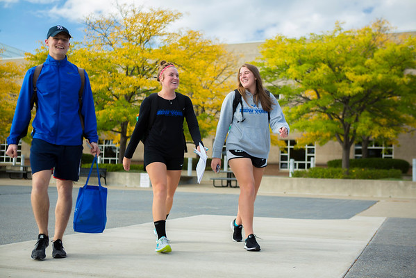 Students by the Center for the Arts with fall foliage<br /> <br /> Photographer: Douglas Levere