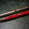 "A pen and pencil set I made for my friend Dan Zimmerlin, who enjoys both rock climbing and trout fishing.  Red pen is made from a climbing rope, encased in plastic resin.  The ""fish pencil"" is make from the skin of a trout, encased in plastic."