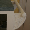 Handle support is hand carved.  Matching design on other side.  Design is from decorative tile used as accent in kitchen.