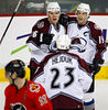 Colorado Avalanche's Paul Stastny, top left, Joe Sakic (19), and Milan Hejduk, center, celebrate Stastny's goal as Calgary Flames' Stephane Yelle skates away during second period NHL hockey action in Calgary Tuesday, April 3, 2007.(AP PHOTO/CP, Jeff McIntosh) CANADA